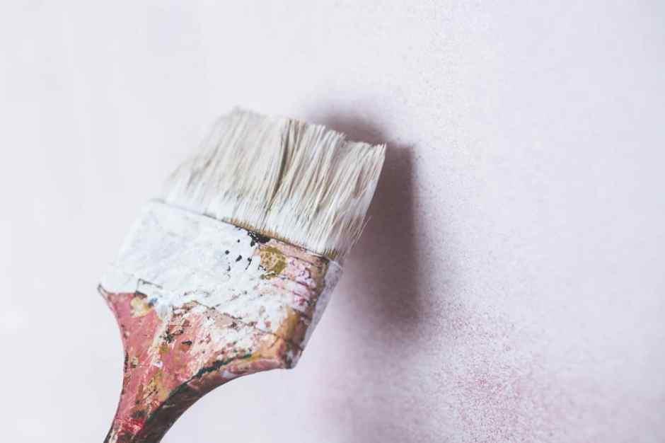 Brush paining a wall white